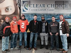 Group of People Tailgating with the Clear Choice Logo in the Background